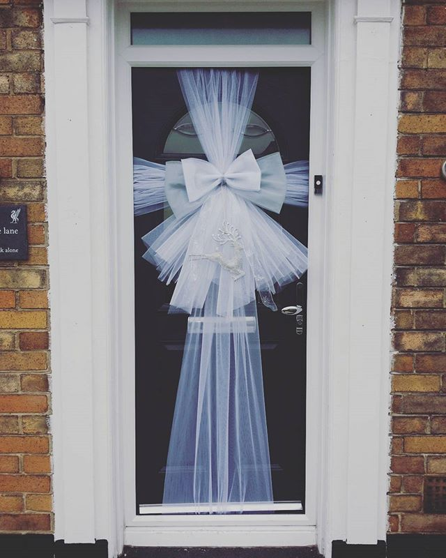 Silver and white against a dark grey door ❤__#doorbowsliverpool #doorbow #doorbows #silverdoorbow #s