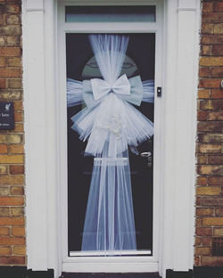 Silver and white against a dark grey door ❤__#doorbowsliverpool #doorbow #doorbows #silverdoorbow #s