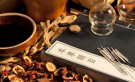 Acupuncture needles, glass cups, dried herbs, book.