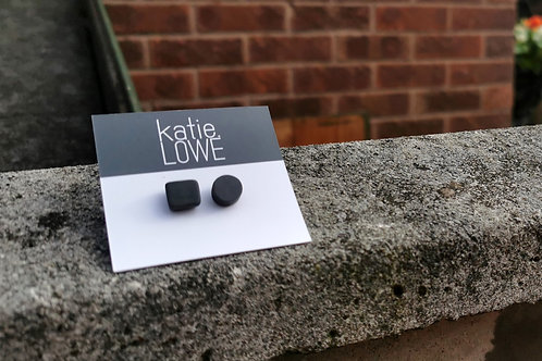 mix and match black stud earrings.