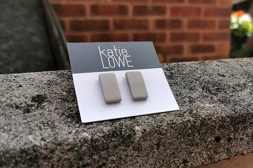 rectangle pale grey stud earrings.