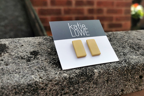 rectangle yellow stud earrings.