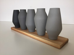 five small plinth grey
