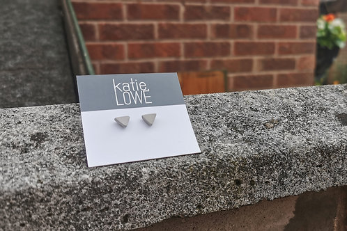 tiny triangle grey stud earrings.