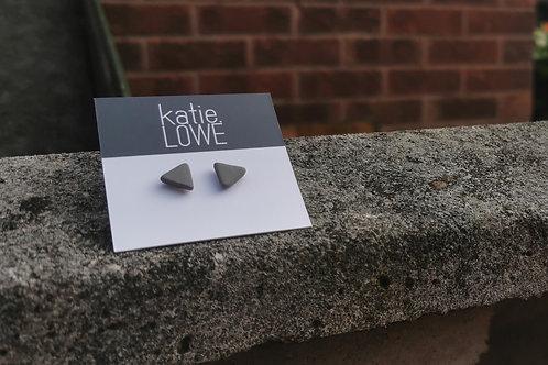 triangle grey stud earrings.