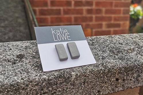 rectangle grey stud earrings.