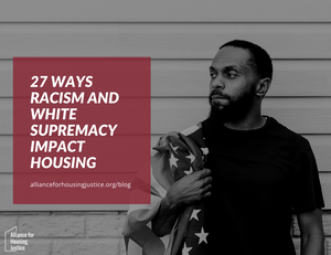 "A Black man stands near a wall looking in the distance while holding an American flag over his shoulder. The text on the image says, ""27 Ways Racism and White Supremacy Impact Housing"""