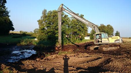 Oprensnig af sø med long reach gravemaskine