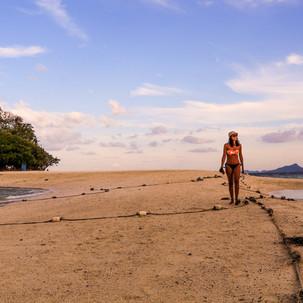 Walking between two beaches.