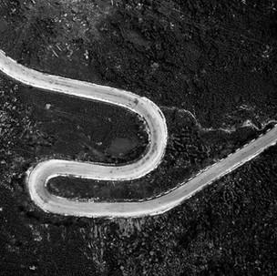 B&W curvy roads.