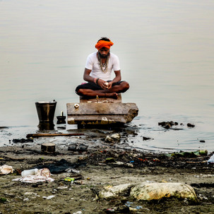 Praying and meditating in the Ganges river.