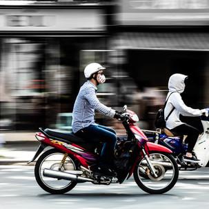 Panning motorbikes in Hanoi.