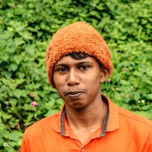 Beanie boy. Orange and green.