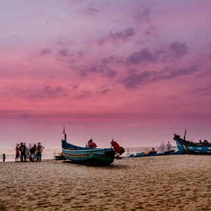 Ghosts appear during purple sunset in Arambol beach.