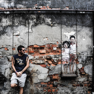 Penang urban art. Brother and Sister on a Swing.