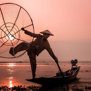 Perfect sunrise with showman/fisherman.