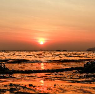 Amazing sunset at Pai Plong beach.