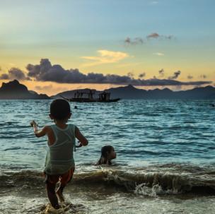 Kids playing during sunset at Cabanas Beach, El Nido!