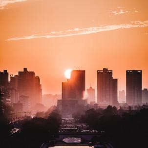 Sunset behind a skyline.