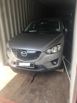 Vehicle Secured in container for shipping