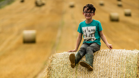 Kade loves the hay bales 2 (1 of 1).jpg