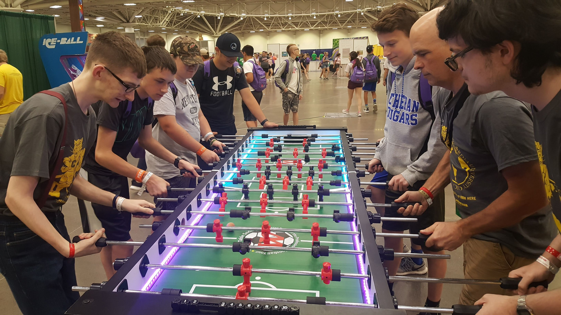 Youth playing foosball