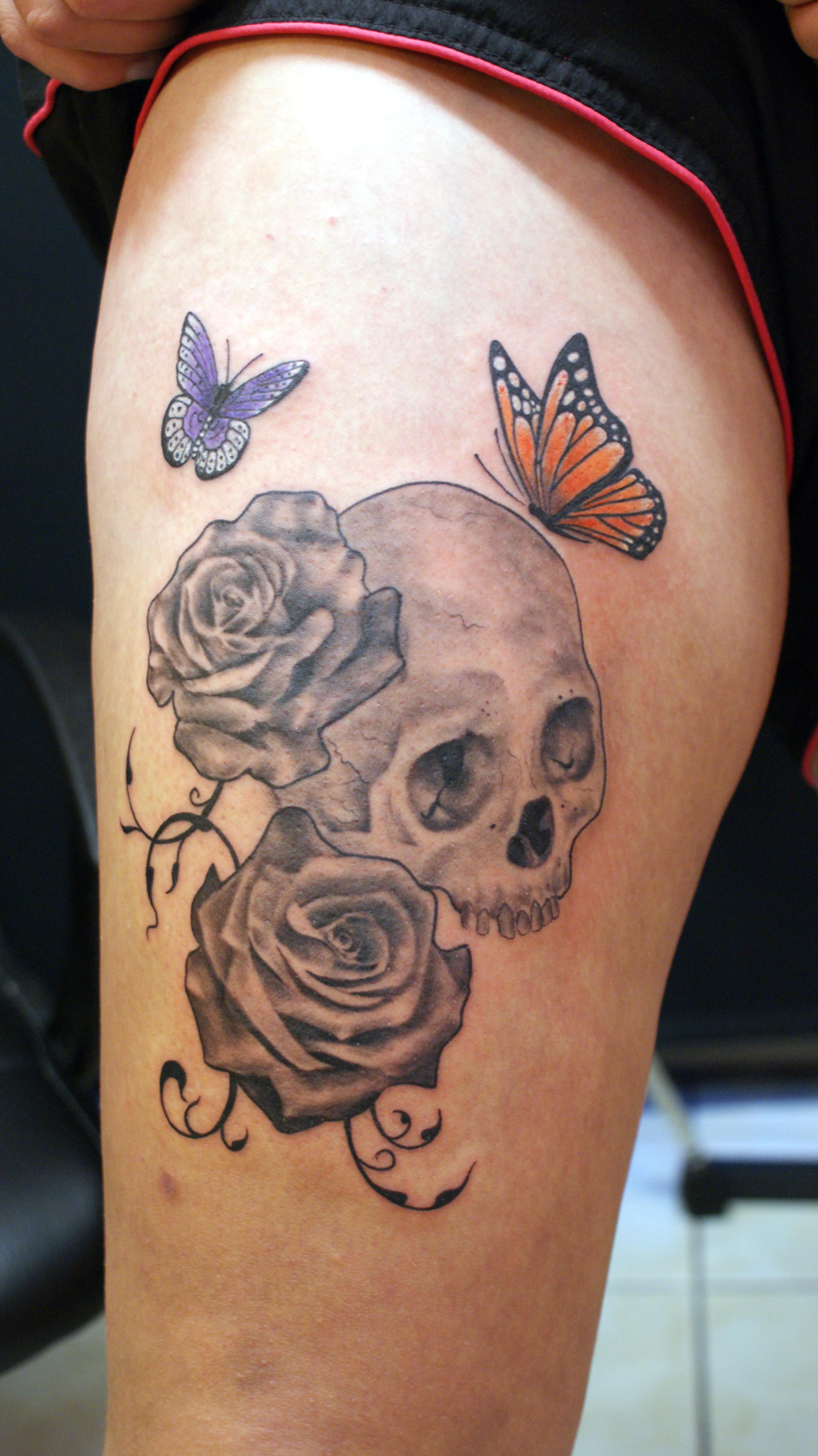 Skull roses butterfly swirls