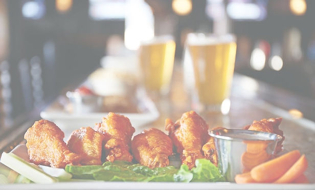 A picture of beer and wings