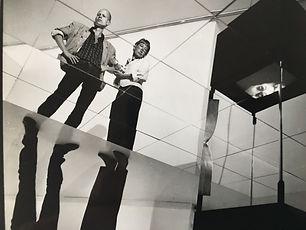 Video installation Eks-rummet, Statens Museum for Kunst, 1987 Med Jacob Frederik Schokking Musik: Dan Marmorstein Sanger/hviskende retsbetjent: Jørgen Larsen  Spejlgulv, B&O monitorer indbyggede i bokse, stående på knive af stål. Gyldent motoriseret pendul med indbygget højttaler. 2 videosøjler med monitor.