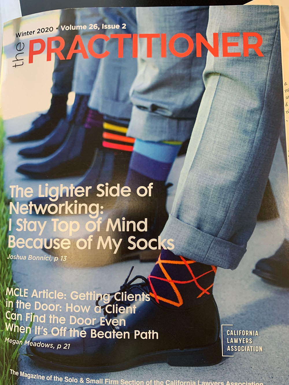 magazine cover showing feet, socks, and legs