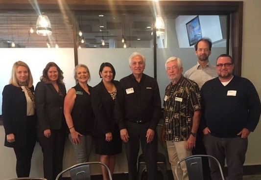 Jennifer Novak and her team members standing and smiling with members of the Palos Verdes Chamber of Commerce