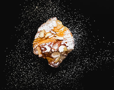 almond croissant, fresly baked, flaky, buttery, powdered sugar croissant,