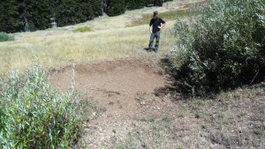 Project Volunteer Luke Ruediger surveys bank trampling and riparian shade reduction on the Silver Fork of Elliot Creek within the Siskiyou Ridge portion of Rogue-Siskiyou National Forest.