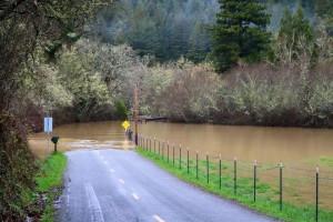 Elk River flowing over road. Photo courtesy of Elk River Residents Association