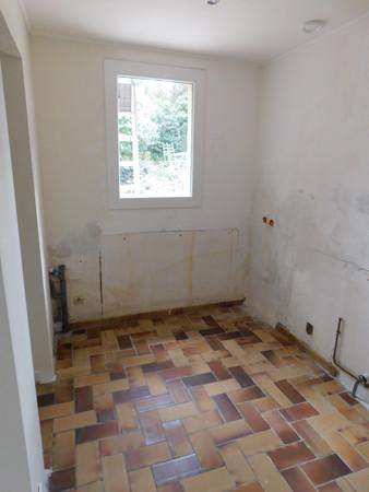Après la dépose des anciens meubles de cuisine