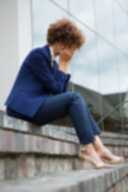 depressed-businesswoman-sitting-in-the-p