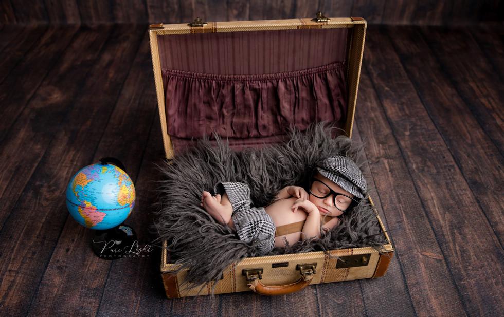 Saskatoon newborn baby boy in suitcase