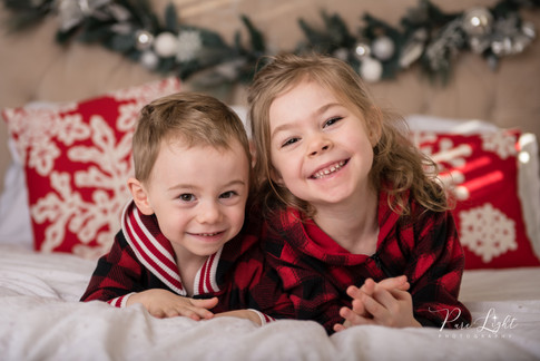 brother and sister in Christmas pyjamas