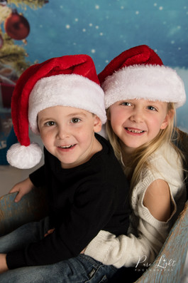 Christmas-kids-on-sled-Santa-hats-1.jpg