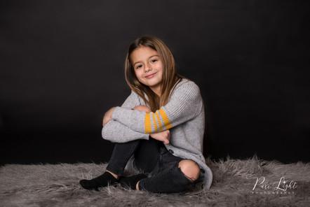 girl studio portrait with black background