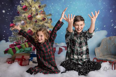 Christmas-siblings-throwing-snow-1.jpg