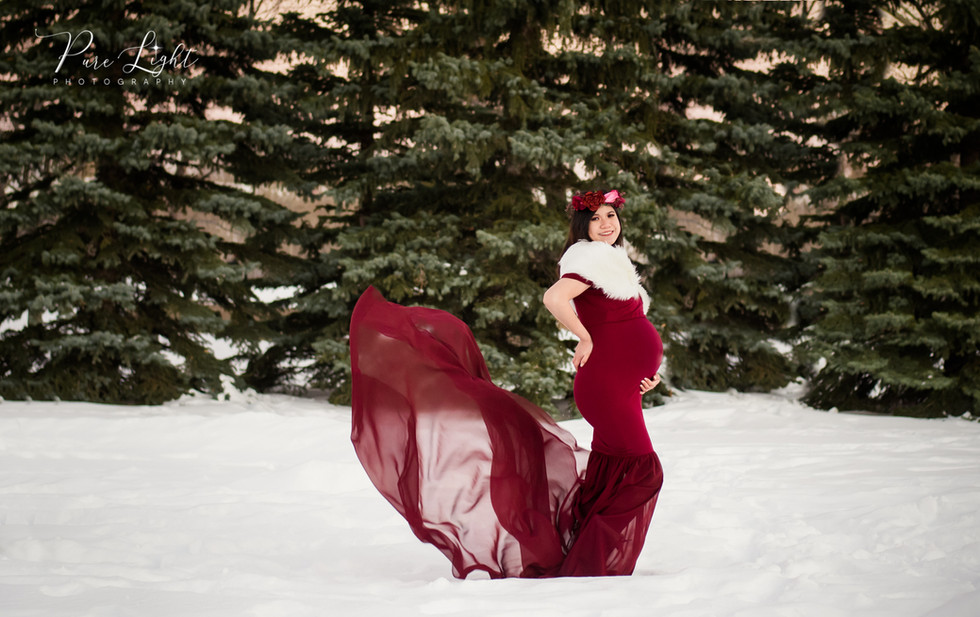 maternity woman outside with red dress