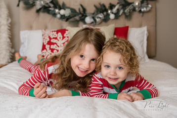 Christmas-pyjamas-sisters-on-tummies-1.j