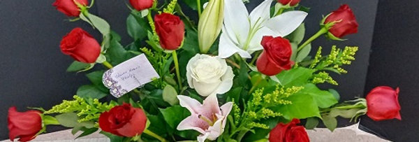 Roses, pasion flowers in a basket