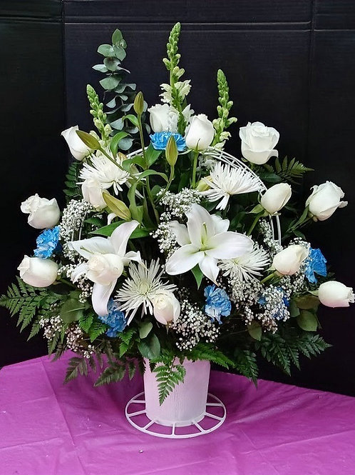 White flowers basket, beautiful flowers in a basket for funeral or sympathy
