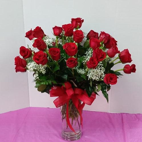 36 roses in crystal vase.