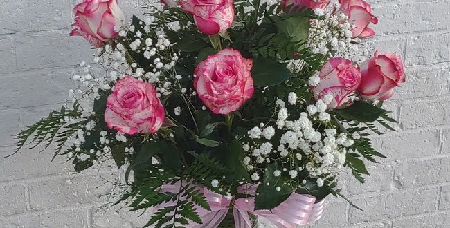 Magic time, pink roses in a vase.
