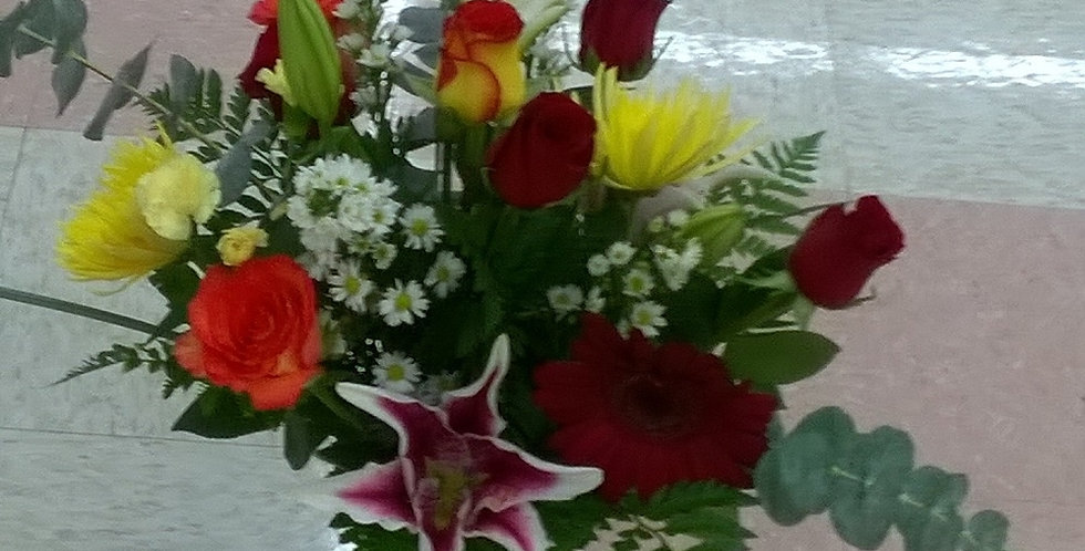 Fascinanting. Red roses, lilly, spiders and orange roses