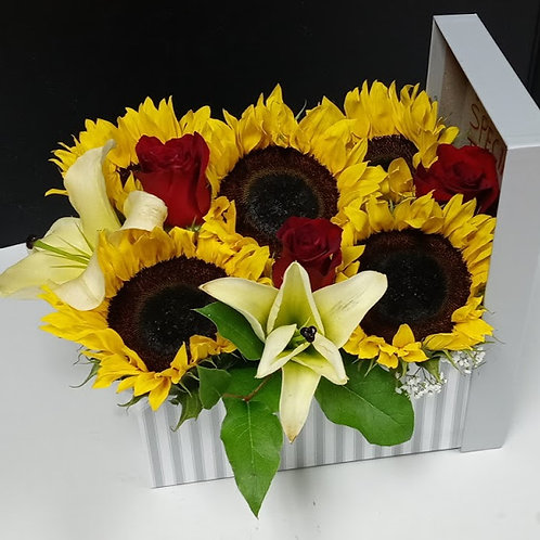 Sunflowers and roses in a vase.