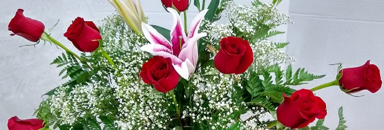 12 Red roses basket.